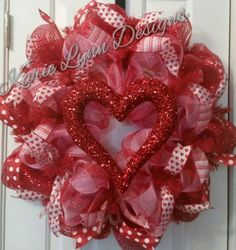This Valentines wreath is made with red and pink deco mesh and accented with red, pink and white valentines day ribbon and Glittered heart Diy Valentines Day Wreath, Valentines Day Party, Valentines Day Decorations, Valentine Day Crafts, Love Valentines, Valentine Ideas, Holiday Decorations, Mesh Ribbon Wreaths, Deco Wreaths