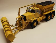 Truck Model with plow and carrier bed.