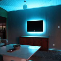 Fab.com | Glo Belt - The Glo Belt turns your flat screen into a mood lighting magic box with the push of a button. Casts an ambient glow behind your TV with a more than 15 different colors. Use the wireless remote to adjust the brightness, color, and speed to suit. Designed for easy-installation, this nifty strip can be extended or minimized to fit most flat screen TVs.