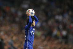 Schalke's Atsuto Uchida throws the ball during a Champions League soccer match round of 16 second leg, between Real Madrid and Schalke 04 at Santiago Bernabeu...