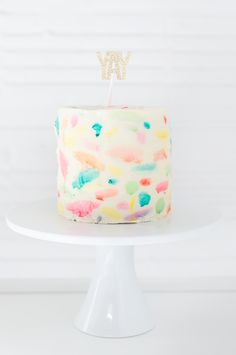 DIY Abstract watercolor painted cake | sugarandcloth.com (YAY glitter letters via the Bannerie)
