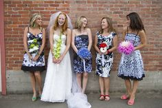 Different dresses but each has a bouquet that matches their shoes!