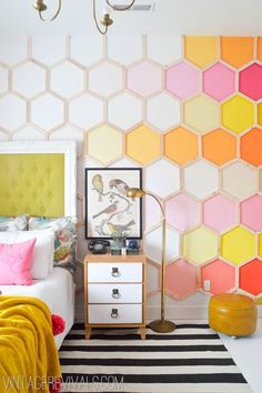 What a fun girl's bedroom makeover with a vibrant DIY Rainbow HoneyComb Wall!
