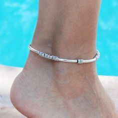 Kiko Anklet in Silverplate and Single Leather Strand – Lizzy James Silver Ankle Bracelet, Ankle Jewelry, Anklet Bracelet, Ear Jewelry, Bracelets, Silver Anklets Designs, Anklet Designs, Jewellery Designs, Rose Gold Earrings