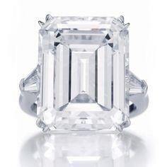 Classic emerald-cut diamond engagement ring from Harry Winston.