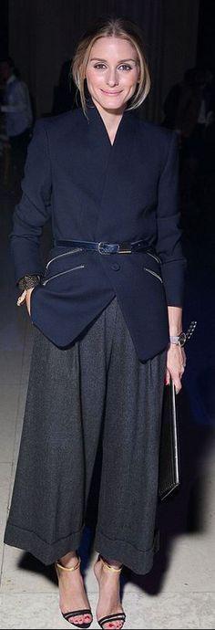 Who made  Olivia Palermos blue zipper blazer, belt, gray wide leg pants, clutch handbag, and gold sandals?
