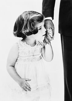 Caroline Kennedy holding her father John F. Kennedy's hand, photographed by Richard Avedon, 1960.