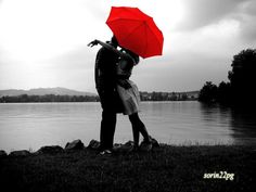 love is... sharing an umbrella. and exchanging kisses in the rain.