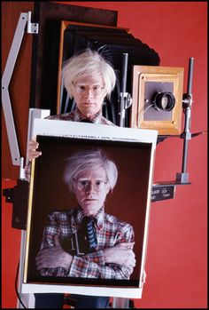 Andy Warhol with Polaroid of himself in 1980 by Bill Ray (Polaroid's 20x24 Camera)