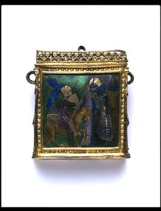 """Pendant case, France/England, 1325, silver, silver gilt & translucent enamels. The top panel slides to open; the inscription """"AVE MARIA GRACIA PL[ENA]"""" is engraved in Lombardic lettering. The enamel plaques feature heraldic and romantic scenes.  It was made to hold spices & scents to combat the rather pungent air that surrounded most cities and towns.  This personal treasure was intended to be worn around the neck, or suspended from a belt or girdle."""