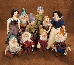 R. John Wright Snow White and the Seven Dwarfs and Snow White in Rags.  LE felt dolls.