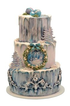 Christmas cake in blue and white ~ love the wreath with hand painted winter scene of two birds...