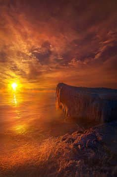 A sub zero sunrise on the shore of Lake Michigan in Wisconsin. USA.