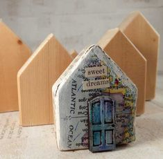 Wooden house shaped blocks. Could print front doors for chn to add?