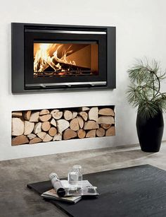 Contemporary built-in wood-burning stove - Wood Burning Fireplace Inserts Wood Burner Fireplace, Wood Burning Fireplace Inserts, Fireplace Wall, Fireplace Design, Fireplace Ideas, Fireplace Remodel, Wood Burning Stove Insert, Wood Burning Fires, Modern Stoves