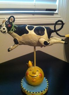 Lori Mitchell Folk Art Figurines, Nursery Rhyme Collection. The Cow Jumped Over the Moon