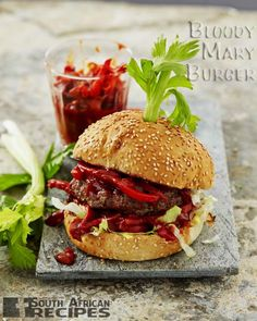 BLOODY MARY BURGER By Jan Braai Millions of people around the world enjoy the combination of ingredients that makes up the Bloody Mary cocktail. Braai Recipes, Burger Recipes, Snack Recipes, Cooking Recipes, Snacks, South African Recipes, Ethnic Recipes, Man Food, Bloody Mary