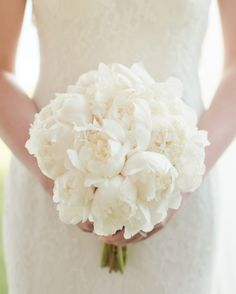 Atelier Joya used classic white peonies in this bouquet to complement the wedding's color scheme.