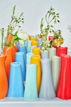 Group together colourful vases