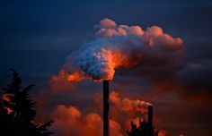 Smokestack emissions interact with the environment.