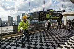 V8 Vantage GTE Challenger lowered onto the 30th floor of Dollar Bay.