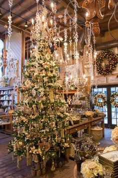 I love the dangling crystal ornaments suspended from the ceiling. Remember this for the dining room. Also hanging above the mantel.