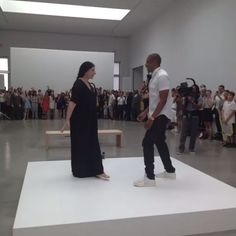 """To promote his new art-themed album Magna Carta Holy Grail, Jay-Z is spending six hours rapping along to his song """"Picasso Baby"""" at the Pace Gallery in New York. The performance art will eventually culminate in a music video for the song, but for now it's being recorded on Instagram videos and Vines. Here he is dancing with Marina Abramovic."""