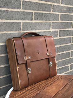 FREE SHIPPING within the United States! A beautiful and well-constructed everyday bag which totally built by hand. Hand made with full grain vegetable tanned leather and hand polished wood frame. Inner pockets are hand stitched with waxed threads. Remarkable patina along with the