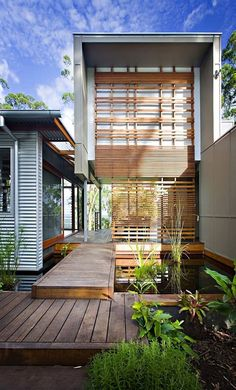 Eco friendly house in Australia.. Wooden pathways could be built around the community