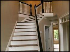 Painting the handrail with Benjamin Moore oil paint in black does just the trick still traditional but what I like to call updated traditional.