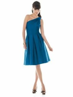 Cocktail Length, one shoulder Dupioni dress, with inverted pleats at inset midriff and shirred detail at shoulder. Pockets at skirt side seams.