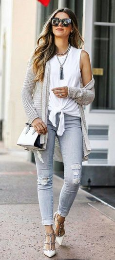 #fall #outfits  women's white sleeveless crop top and blue denim pants with gray knitted cardigan