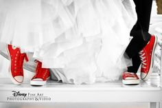 Totally doing this.  Different colors, but serious!  There are few publicly worn shoes as comfortable as chucks, and I'm going to be on my feet for my entire reception!