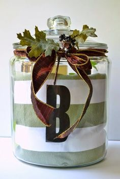 This is monogrammed, but any jar and dish towel would work. Love this as a Christmas gift idea with a holiday kitchen towel, too.