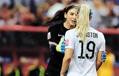 Hope Solo consoles Julie Johnston after Johnston's foul in the box led to a penalty kick by Germany in the World Cup semifinal, June 30, 2015.