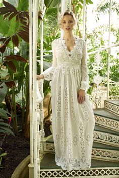 Carbonne Dress | Francis Bridal | Gorgeous broderie anglais embroidered chiffon forms this beautiful boho wedding dress. The plunge neckline is softened by the scalloped edges of the lace, allowing you to increase coverage if necessary.
