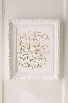 Gilded quote in white frame