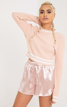 Nude Tipped Knitted Crop TopLook super cute in this crop top. Featuring must-have knitted fabric,...