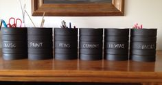 Old formula tins with a dash of blackboard paint, organises the kiddies stationary!