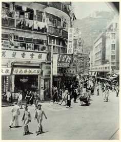 Can anyone identity the location of this pic? Is it somewhere in Wanchai or Causeway Bay? On the right is a hotel, however, the name of the hotel is hardly to see. History Of Hong Kong, Fan Ho, China Hong Kong, Thing 1, Macau, Old City, Vintage Photographs, Shanghai, Old Photos