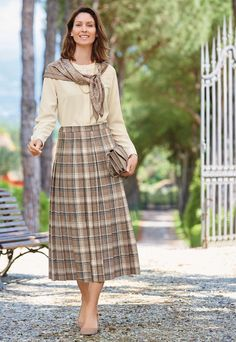 Coordinating silk scarf with kilted skirt.  A classic!