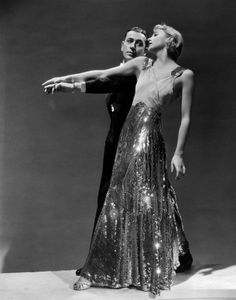 """Raoul De Baere (George Raft): """"You wouldn't get rich on what I'd pay you."""" // Helen Hathaway (Carole Lombard): """"There are other ways to get rich."""" -- from Bolero (1934) directed by Wesley Ruggles"""