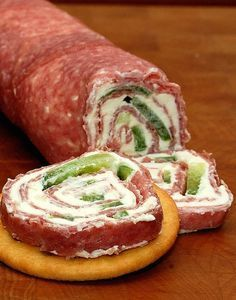 salami rolls. Mix green onions in cream cheese and layer with red and Green peppers for Christmas