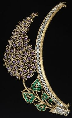 A 19th century frontlet or tiara, made of gilt metal and decorated with coloured pastes in the shape of a spray of lilac. #antique #tiara