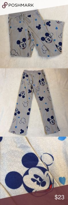 Disney's Mickey Mouse Gray Pajama Pants Mickey Mouse design. Gray and blue. Perfect condition! Drawstring in front to adjust tightness on the waist. 100% polyester. Disney Intimates & Sleepwear Pajamas