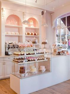 Pink bakery interior-- love the molding on the shelves and clear glass. It is elegant and feels less cluttered and clean.