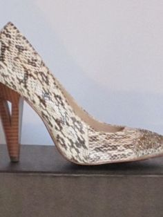 just the little wedge cutout in the heel makes these shoes super sexy, even with the lower heel,