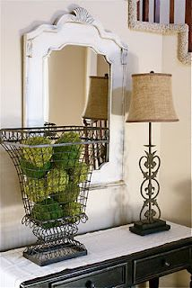 Use old lamp, strip, cover with chicken wire, spray paint, and fill with moss covered styrofoam balls....LOVELY!