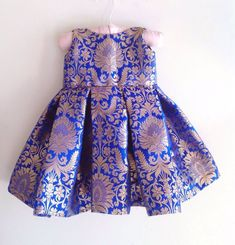 Royal blue brocade dress with bow at back 💙 Available in different colours Perfect for coming festive season ✨ Girls Frock Design, Kids Frocks Design, Baby Frocks Designs, Baby Dress Design, Baby Girl Frocks, Frocks For Girls, Little Girl Dresses, Kids Dress Wear, Kids Gown