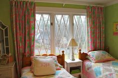 Bedroom curtains, quilts and throw pillows by Lilly Pulitzer.